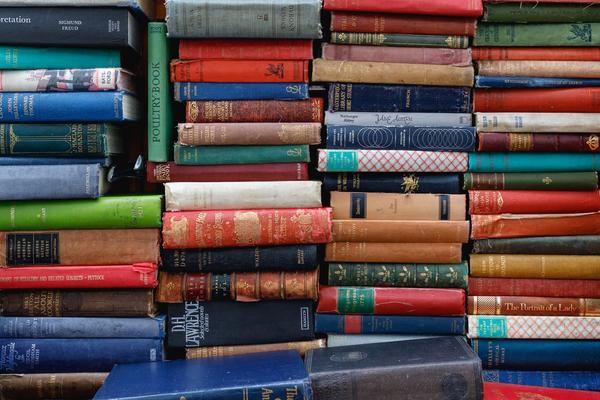 books piled up with spines visible
