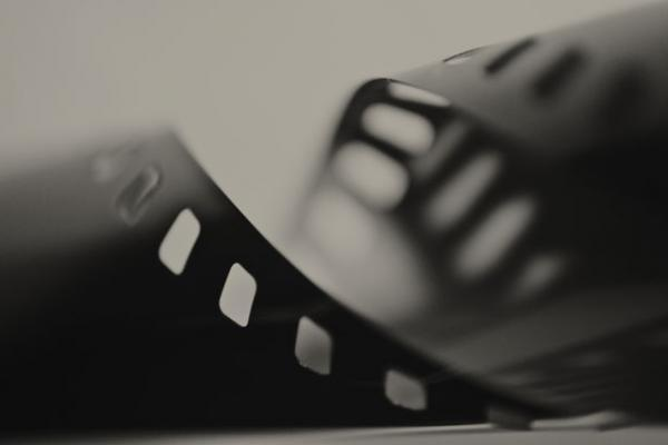 Close-up of film reel in black and white